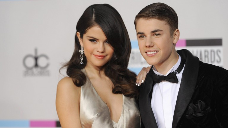 Selena Gomez, left, and Justin Bieber arrive at the 39th Annual American Music Awards on Sunday, Nov. 20, 2011 in Los Angeles. (AP Photo/Chris Pizzello)