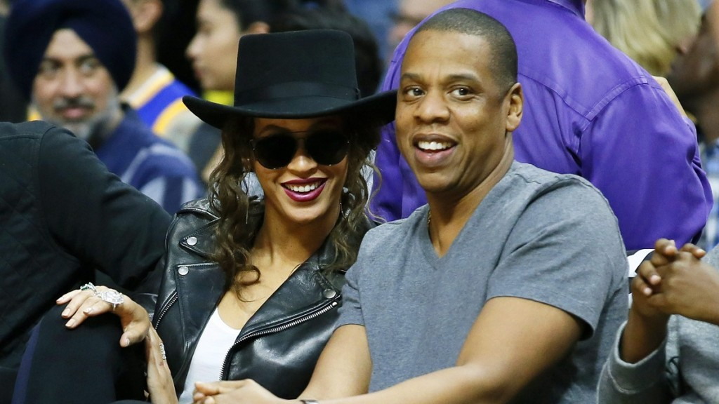 FILE - In this Feb. 20, 2016 file photo, Beyonce and Jay Z attend the NBA basketball game between the Los Angeles Clippers and Golden State Warriors, in Los Angeles. The couple were married on April 4, 2008, in a private ceremony at their Tribeca apartment. (AP Photo/Danny Moloshok, File)