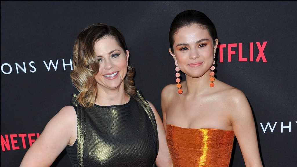 "Mandy Teefey and daughter actress/executive producer Selena Gomez attend the Premiere of Netflix's ""13 Reasons Why"" at Paramount Pictures on March 30, 2017 in Los Angeles, California. (Allen Berezovsky/WireImage for Fashion Media)"