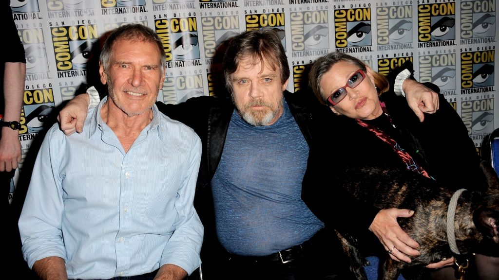 SAN DIEGO, CA - JULY 10: (L-R) Actors Harrison Ford, Mark Hamill and Carrie Fisher speak onstage at the Lucasfilm panel during Comic-Con International 2015 at the San Diego Convention Center on July 10, 2015 in San Diego, California. (Photo by Albert L. Ortega/Getty Images)