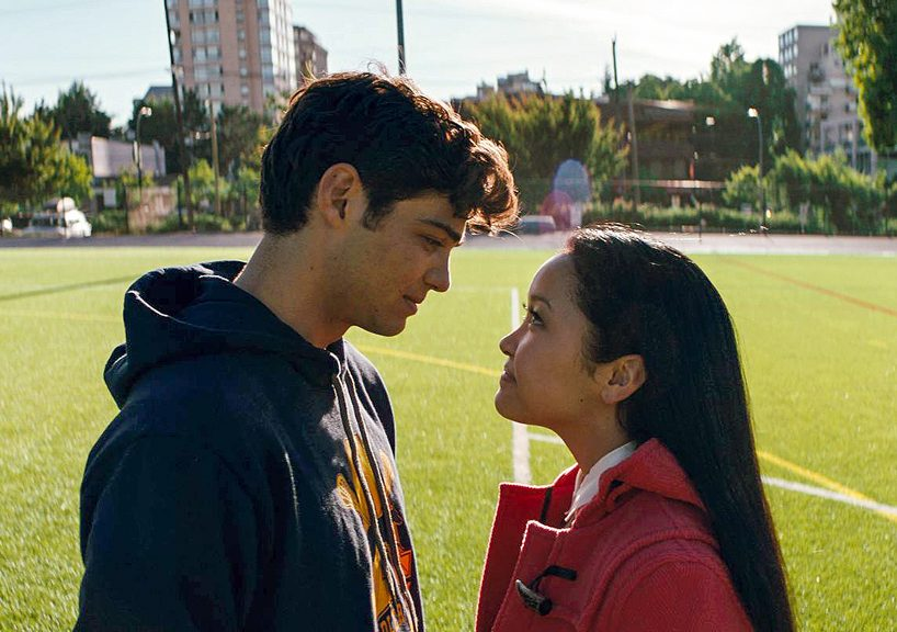 Peter Kavinksy and Lara Jean Covey standing in a field looking at eachother (Photo: Netflix)