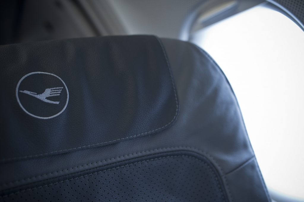 MUNICH - OCTOBER 28: Lufthansa Logo on a airplane Seat in a plane on October 28, 2013 in Munich, Germany. (Photo by Michael Gottschalk/Photothek via Getty Images)
