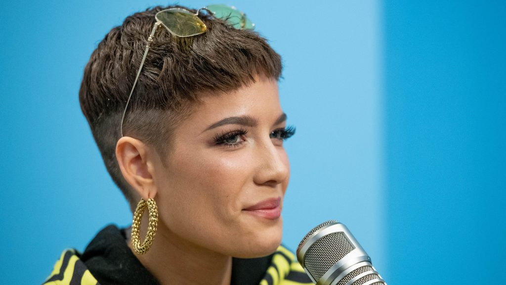 """NEW YORK, NEW YORK - NOVEMBER 09: Halsey discusses the """"Victoria's Secret Fashion Show"""" with The Elvis Duran Show at Z100 Studio on November 09, 2018 in New York City. (Photo by Roy Rochlin/Getty Images)"""