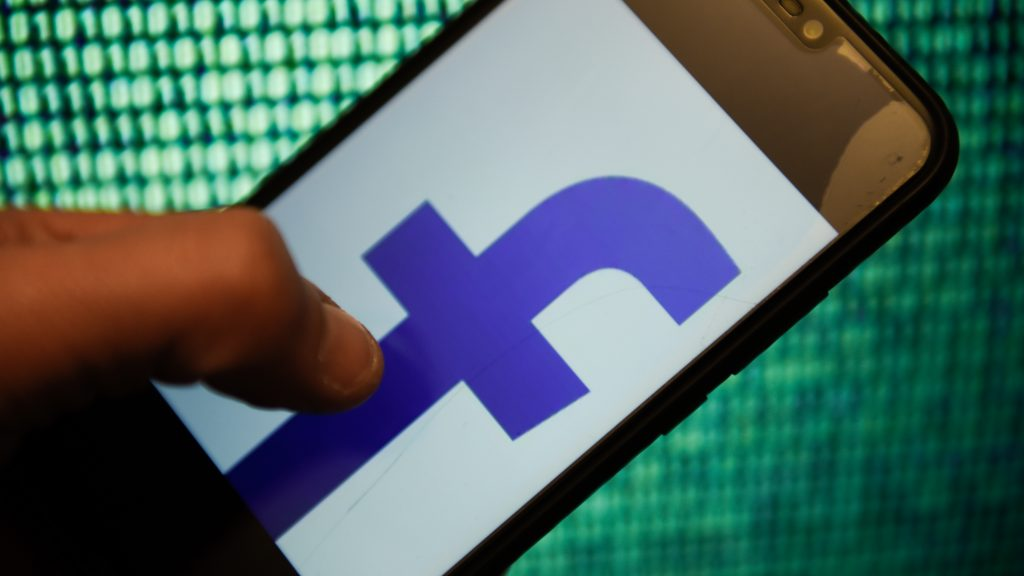 KRAKOW, POLAND - 2018/12/18: Facebook logo is seen on an android mobile phone. (Photo by Omar Marques/SOPA Images/LightRocket via Getty Images)