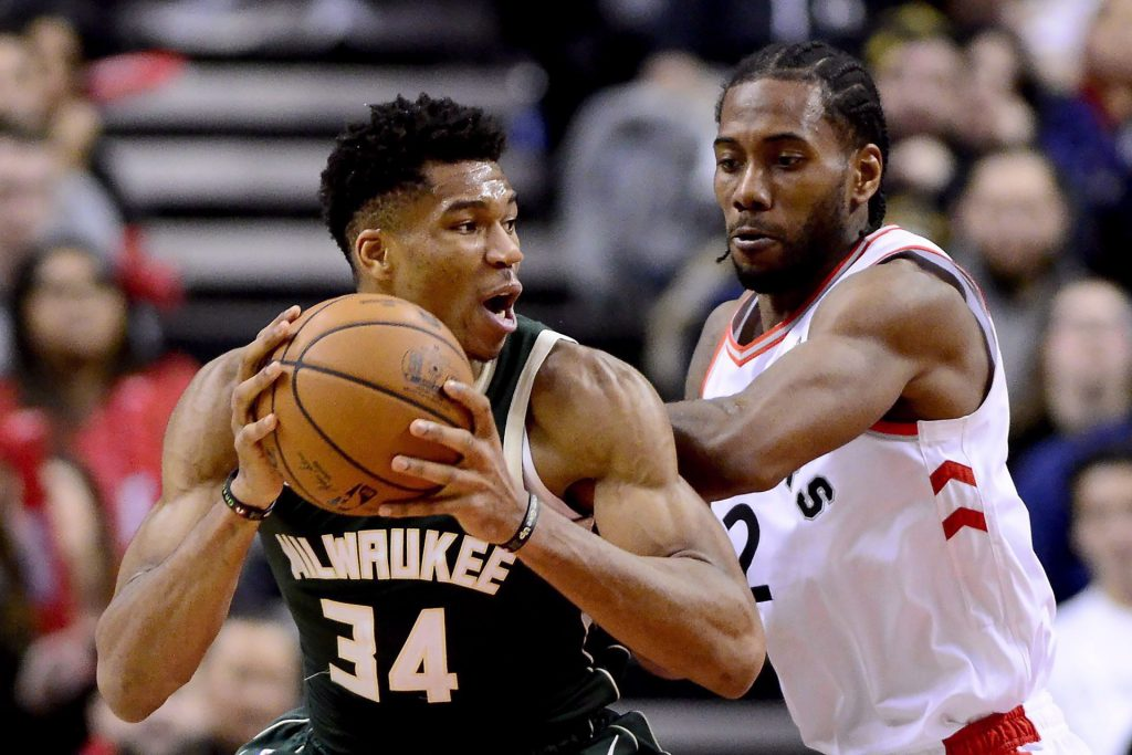 Toronto Raptors forward Kawhi Leonard (2) puts pressure on Milwaukee Bucks forward Giannis Antetokounmpo (34) as he looks for the pass during second half NBA basketball action in Toronto on Sunday, Dec. 9, 2018. The NBA Eastern Conference final features an obvious storyline in a matchup between Toronto superstar Leonard and Milwaukee MVP candidate Giannis Antetokounmpo. THE CANADIAN PRESS/Frank Gunn